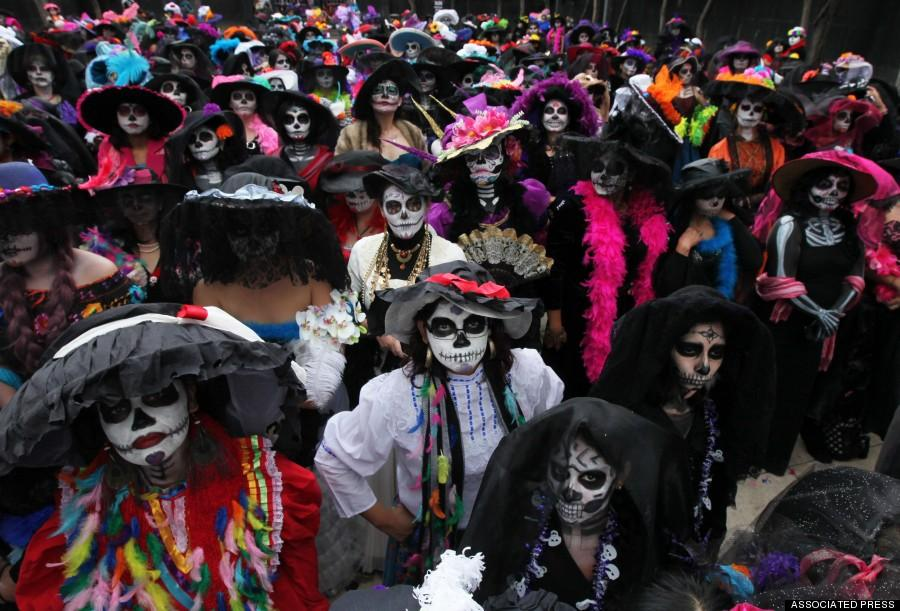 Women+dressed+as+iconic+Mexican+%22Catrinas%22+gather+in+an+attempt+to+set+a+record+for+the+most+Catrinas+in+one+place+during+Day+of+the+Dead+celebrations+in+Mexico+City%2C+Saturday%2C+Nov.+1%2C+2014.+The+figure+of+a+skeleton+wearing+an+elegant+broad-brimmed+hat+was+first+done+as+a+satirical+engraving+by+artist+Jose+Guadalupe+Posada+sometime+between+1910+and+his+death+in+1913.+%28AP+Photo%2FMarco+Ugarte%29