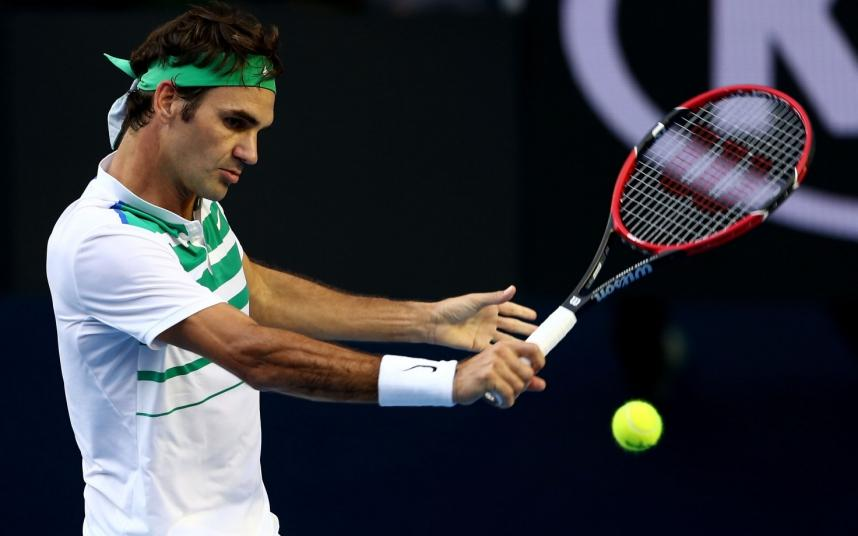 MELBOURNE, AUSTRALIA - JANUARY 18:  Roger Federer of Switzerland plays a backhand in his first round match against Nikoloz Basilashvili of Georgia during day one of the 2016 Australian Open at Melbourne Park on January 18, 2016 in Melbourne, Australia.  (Photo by Cameron Spencer/Getty Images)