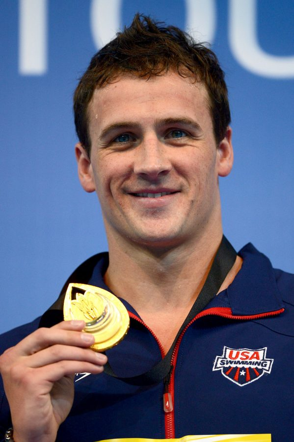 ISTANBUL, TURKEY - DECEMBER 14:  Ryan Lochte of USA poses with his Gold medal on the podium after winning the Men's 200m Individual Medley Final during day three of the 11th FINA Short Course World Championships at the Sinan Erdem Dome on December 14, 2012 in Istanbul, Turkey.  (Photo by Clive Rose/Getty Images)